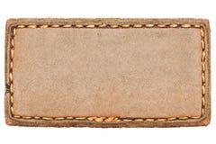 Etiqueta de couro em branco das calças de brim no branco Foto de Stock
