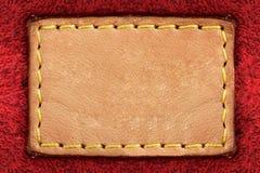 Etiqueta de cuero amarilla en blanco Imagen de archivo