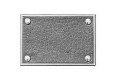 Etiqueta de cuero gris en un marco metálico Imagen de archivo