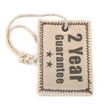 Etiqueta de dos años de la garantía sobre blanco Imagen de archivo libre de regalías