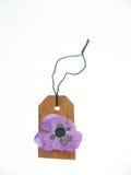 Etiqueta de la caída con una flor Fotografía de archivo libre de regalías