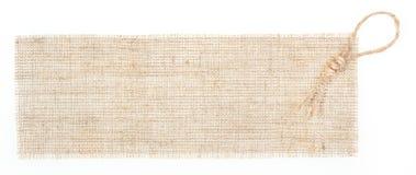 Etiqueta de la harpillera con la decoración sobre blanco Imagen de archivo libre de regalías