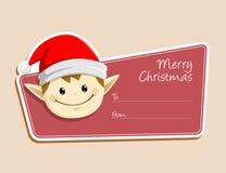 Etiqueta de la Navidad con la cara del duende Fotos de archivo