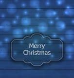 Etiqueta de la Navidad en textura de madera con la luz Fotos de archivo
