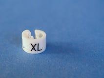 Etiqueta de la talla del XL imagenes de archivo