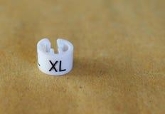 Etiqueta de la talla del XL imágenes de archivo libres de regalías