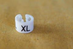 Etiqueta de la talla del XL fotografía de archivo libre de regalías