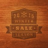 Etiqueta de la venta de 2015 inviernos en la textura de madera Vector Imagen de archivo libre de regalías