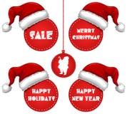 Etiqueta de la venta del Año Nuevo y de los días de fiesta de la Navidad con el casquillo Imagenes de archivo