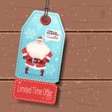 Etiqueta de la venta de la Navidad con Santa On Wooden Background libre illustration