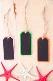 Etiqueta de madera de la etiqueta encendido y pescados de la estrella Foto de archivo libre de regalías
