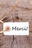 Etiqueta de Merci en la madera imagen de archivo