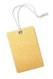 Etiqueta de papel de oro en blanco del precio o del regalo aislada Imagen de archivo libre de regalías