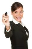 Etiqueta de plástico de la escritura de la mujer de negocios Fotos de archivo
