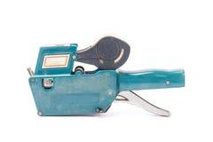 Etiqueta de preço velha, arma da fixação do preço da loja, sombra macia, em um backg branco Imagem de Stock