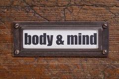 Etiqueta del cuerpo y de la mente fotos de archivo