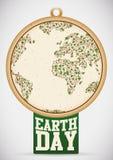 Etiqueta del Día de la Tierra con el planeta hecho con las vides y las hojas, ejemplo del vector Foto de archivo