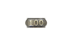 Etiqueta del metal con el número 100 Imagen de archivo libre de regalías