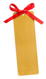 Etiqueta del oro y arco rojo Fotos de archivo
