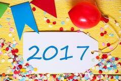 Etiqueta del partido, globo rojo, texto 2017 Imagen de archivo