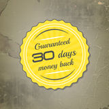 Etiqueta del reembolso del dinero del vector en un fondo retro del grunge Foto de archivo libre de regalías