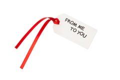 Etiqueta del regalo con el texto Fotografía de archivo