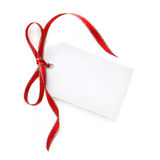 Etiqueta del regalo con rojo y la cinta del oro Imagenes de archivo