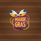 Etiqueta do carnaval do carnaval de Nova Orleães do vetor com máscara e texto no fundo de madeira da parede partido do carnaval d Foto de Stock Royalty Free