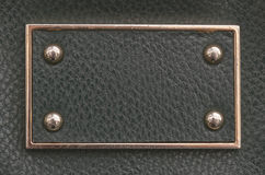 Etiqueta do couro de imitação com beira e rebites do metal Imagens de Stock Royalty Free