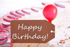 A etiqueta do partido com flâmula, balão, Text o feliz aniversario foto de stock royalty free