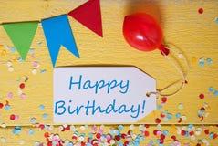 A etiqueta do partido, confete, balão, Text o feliz aniversario Fotografia de Stock