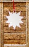 Etiqueta do preço da estrela sobre o fundo do quadro de madeira com espaço da cópia foto de stock royalty free