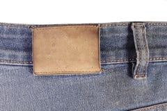 Etiqueta em calças de brim Imagem de Stock