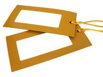 Etiqueta en blanco atada con la cadena amarilla foto de archivo