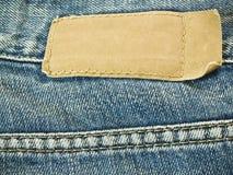 Etiqueta en los pantalones vaqueros Fotos de archivo libres de regalías