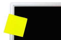 Etiqueta engomada amarilla Imagen de archivo