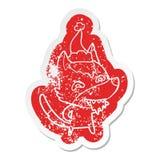etiqueta engomada apenada historieta de un lobo hambriento que lleva el sombrero de santa stock de ilustración