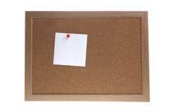 Etiqueta engomada blanca en el tablero Fotos de archivo