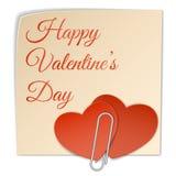 Etiqueta engomada de dos corazones y clip de papel Foto de archivo