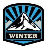 Etiqueta engomada de la montaña del invierno Fotos de archivo libres de regalías