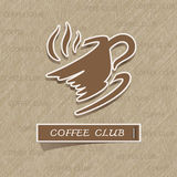 Etiqueta engomada de la taza de café en el papel marrón Fotos de archivo