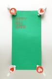 Etiqueta engomada del Año Nuevo con el perno Imagen de archivo