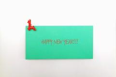 Etiqueta engomada del Año Nuevo con el perno Imágenes de archivo libres de regalías