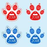 Etiqueta engomada del Año Nuevo de la pata del perro Imagenes de archivo