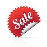 Etiqueta engomada grande roja de la venta en el fondo blanco Imagen de archivo libre de regalías