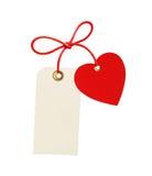 Etiqueta (etiqueta) e coração vermelho isolado no branco imagem de stock