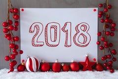 Etiqueta, nieve, bolas de la Navidad, texto 2018 Imagen de archivo libre de regalías
