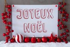 Etiqueta, nieve, bolas, Joyeux Noel Means Merry Christmas Imágenes de archivo libres de regalías