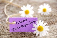 Etiqueta púrpura con acción de gracias feliz Fotos de archivo libres de regalías