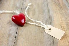 Etiqueta plástica del corazón y de la etiqueta Fotografía de archivo libre de regalías